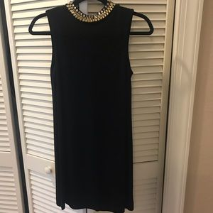 Black dress with gold and silver gems around neck